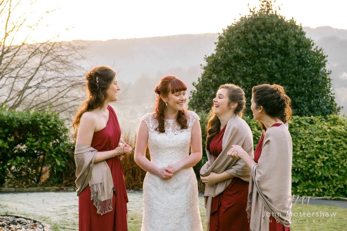 Wedding photograph of bridesmaids laughing together in an informal wedding photograph taken at The Maynard near Sheffield.