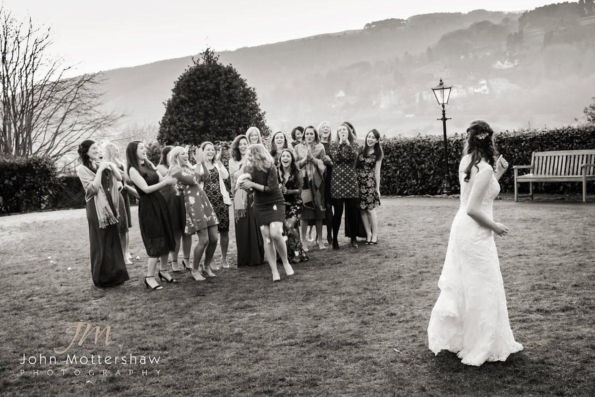 black and white wedding photography at The Maynard near Sheffield. The bride tosses her bouquet.