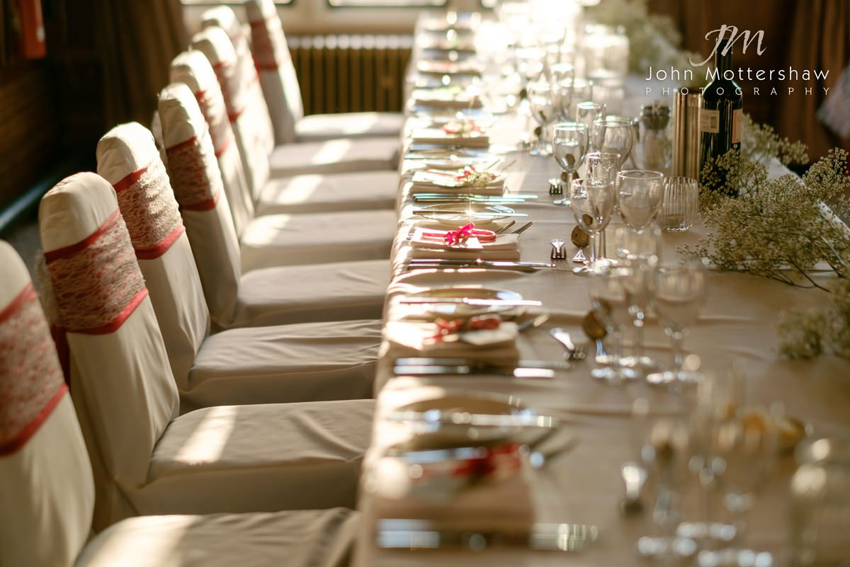 The tables are laid out ready for the wedding breakfast in this wedding photograph at The Maynard, near Sheffield.