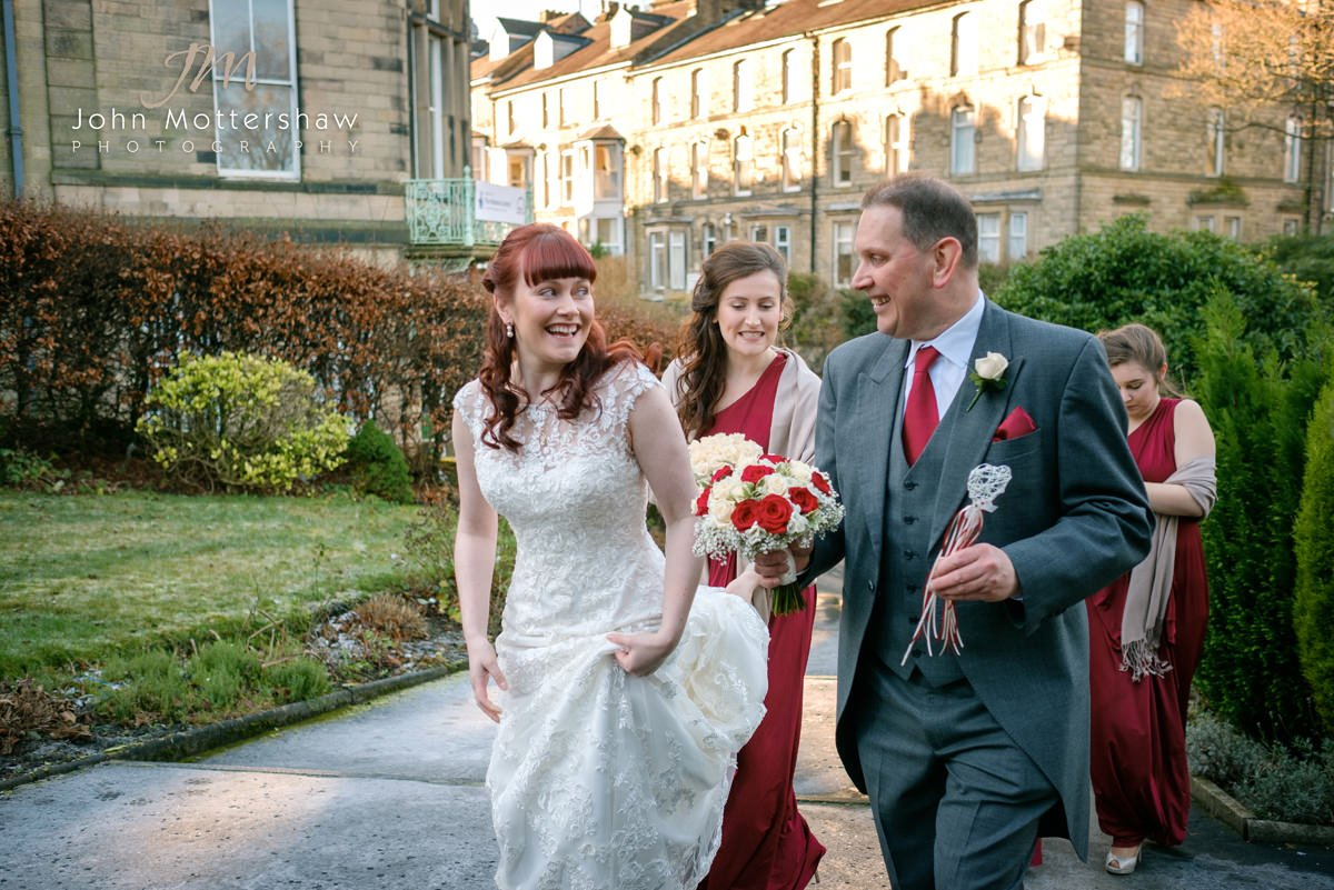 Wedding photography in Buxton. The bride arrives with her father and bridesmaids at Saint Anne's Church in Buxton.