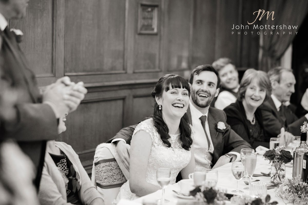 black and white wedding photograph of the bride, laughing at her fathers speech at The Maynard near Sheffield.