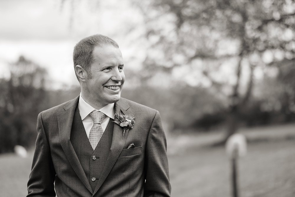 Black and white wedding photography of a groom before his wedding at Losehill House