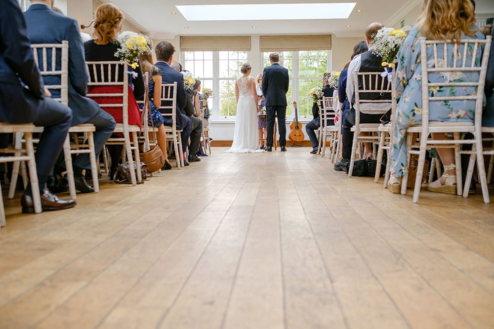 Wedding photographer at Losehill House observes a ceremony at this wedding venue in Derbyshire Peak District.