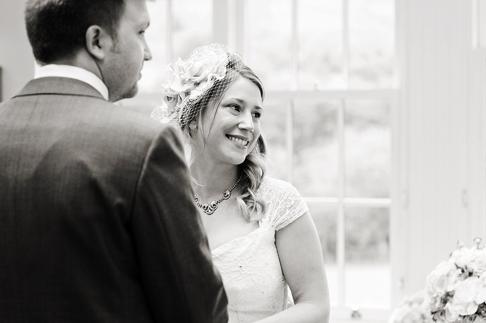 Photograph of a happy looking bride at her civil wedding ceremony in the Derbyshire Peak District.
