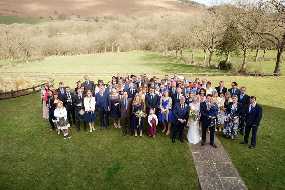 wedding photography of a large group in the gardens of Losehill House