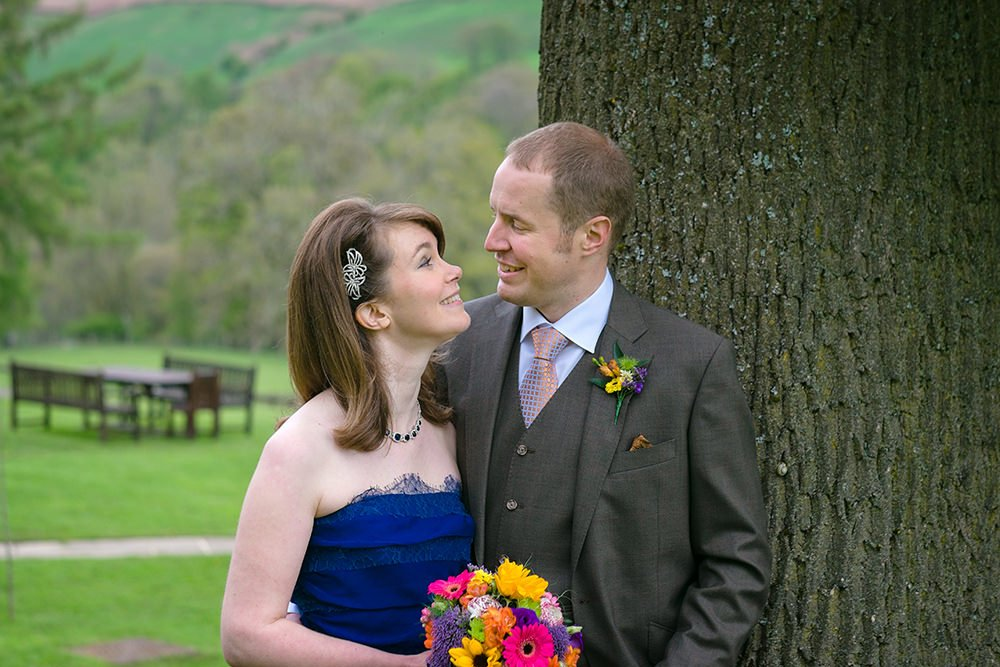 wedding portrait at Losehill of bride and groom by photographer John Mottershaw