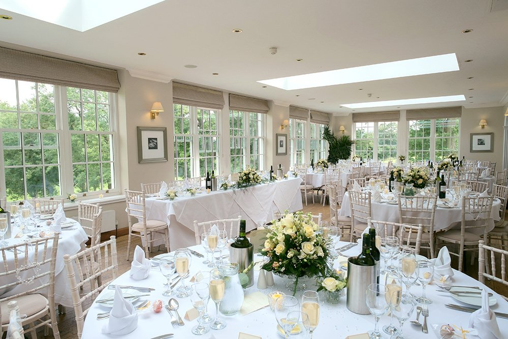 The orangery at Losehill House laid out for a wedding breakfast. Taken by Sheffield wedding photographer John John Mottershaw.