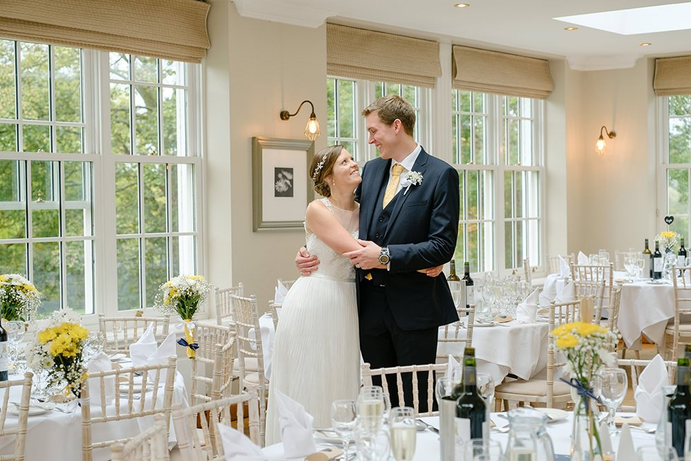 The bride and groom are ready for their guests in this wedding photograph taken at Losehill House