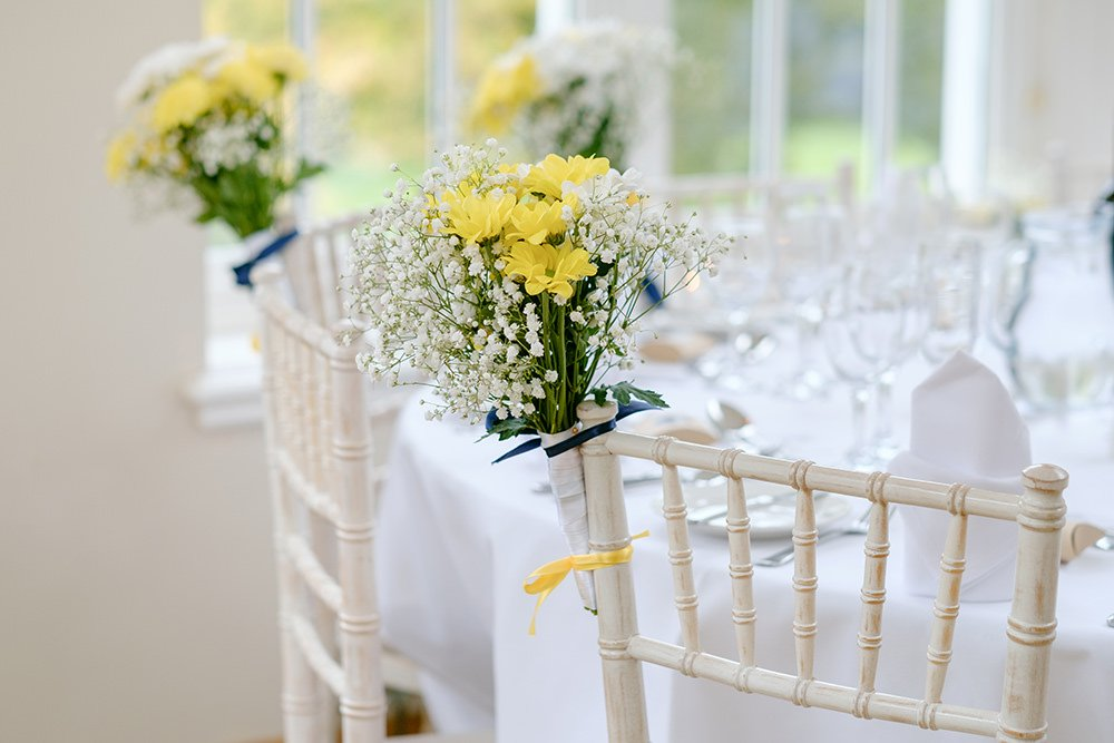 Beautiful spring wedding flowers by the table at a wedding at Losehill House