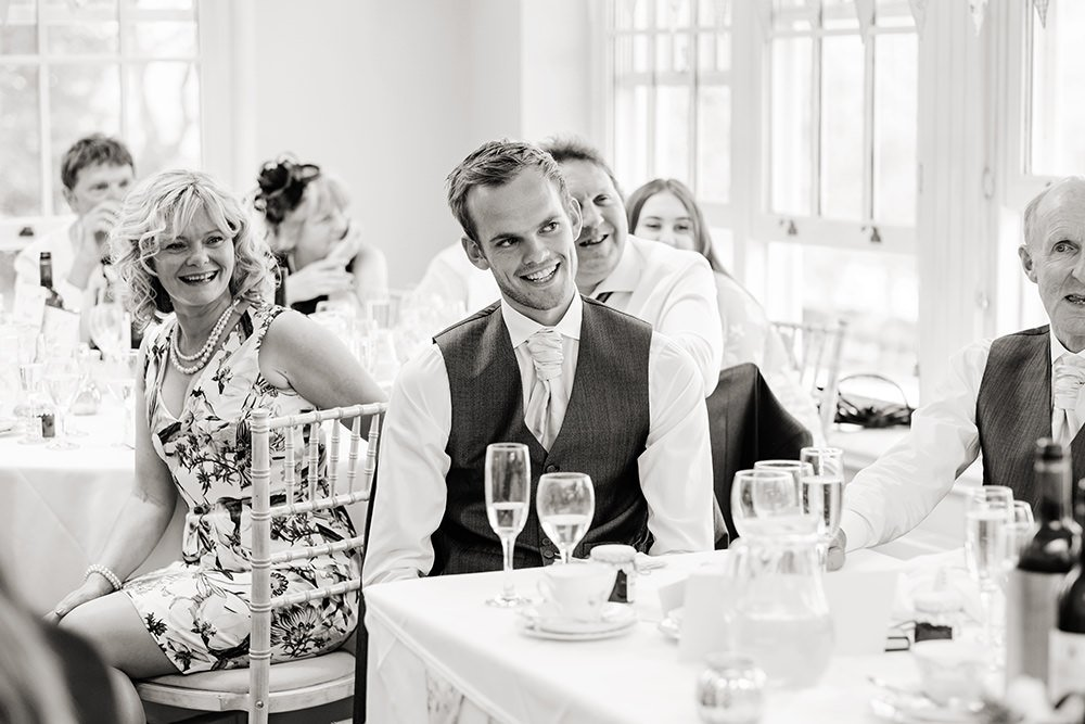 black and white photography of speeches at a wedding at Losehill House