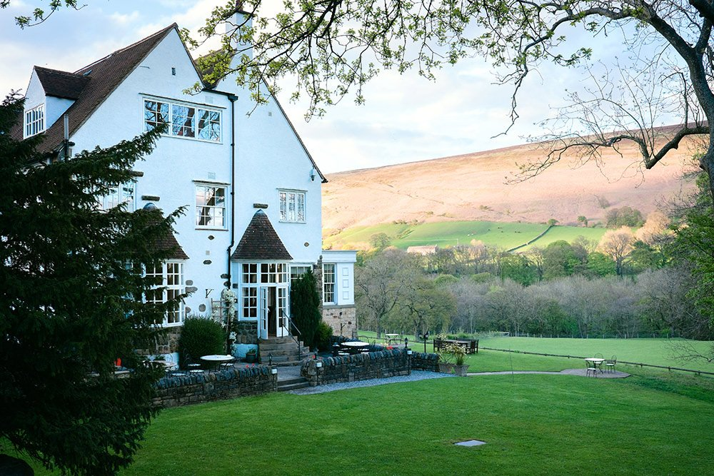 Evening photograph of Losehill House Hotel and the hillside