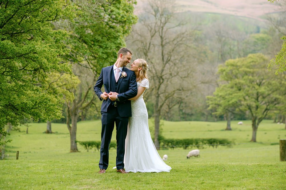 Photo of bride and groom in the Peak District countryside by Sheffield wedding photographer John Mottershaw.