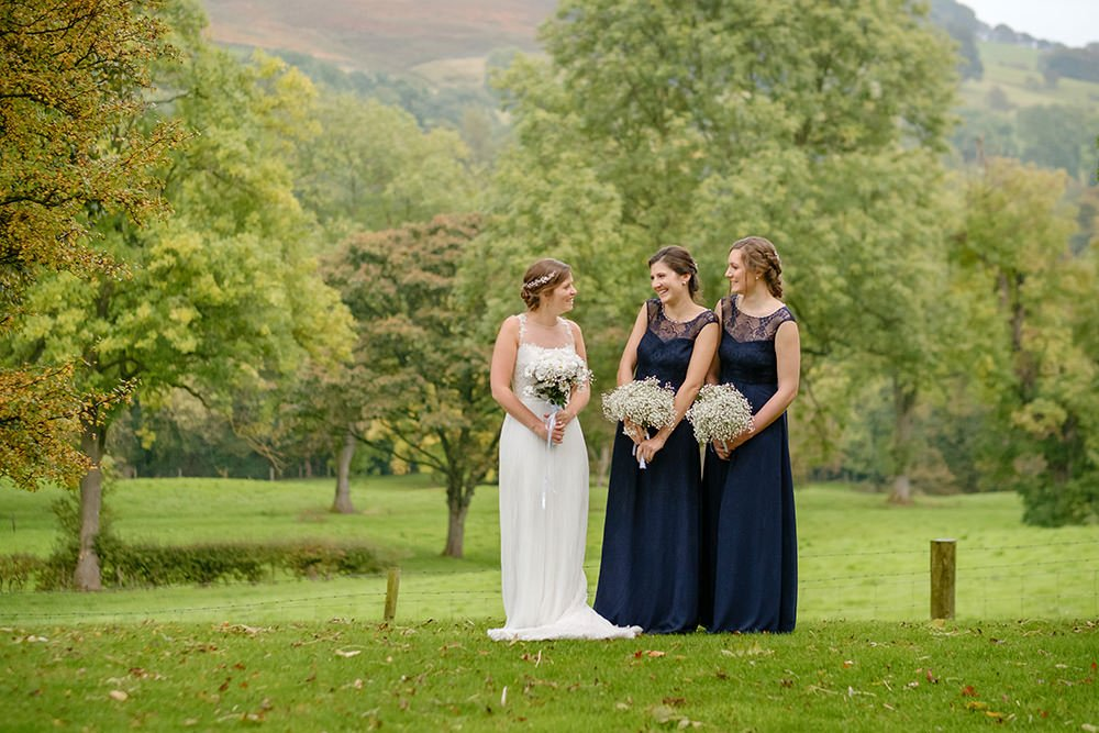 bride and bridesmaids chat at a wedding in the Derbyshire Peak District.