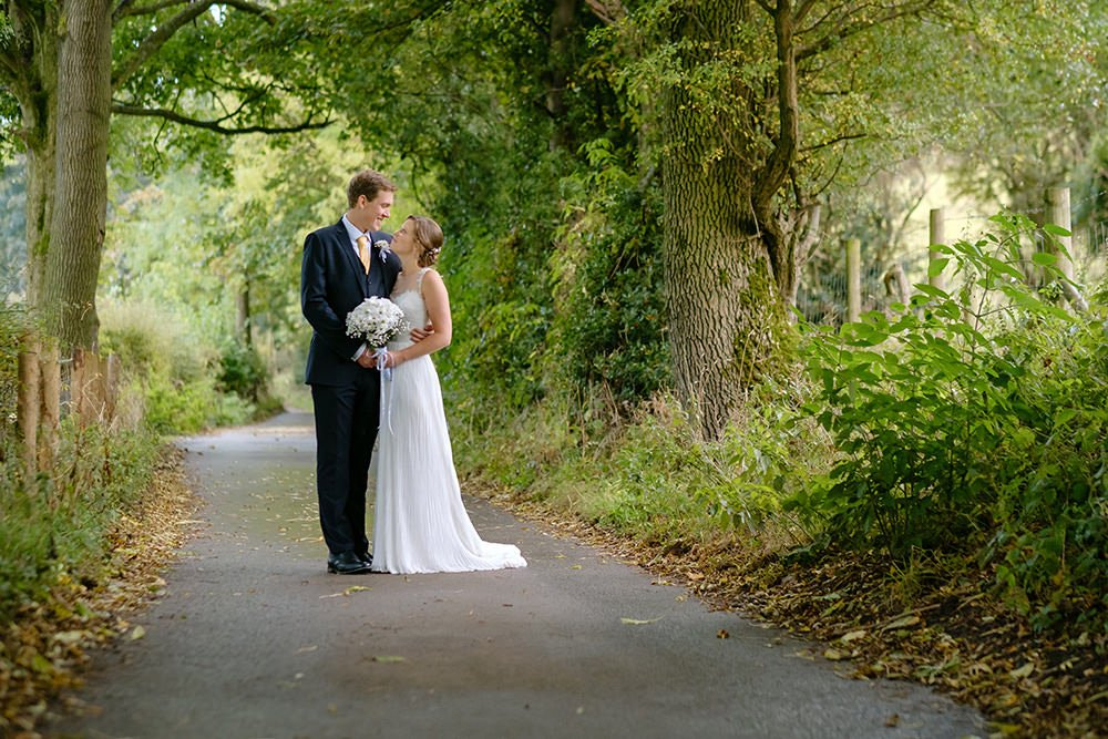 rural Derbyshire wedding photograph of a bride and groom in a lane near Losehill House