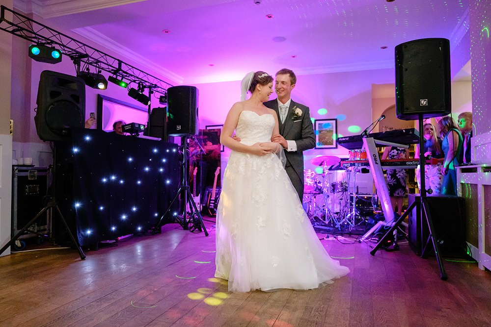 A bride and groom perform their first dance at Losehill House