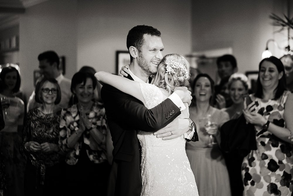 Wedding photography in black and white of a newly married couple and their first dance