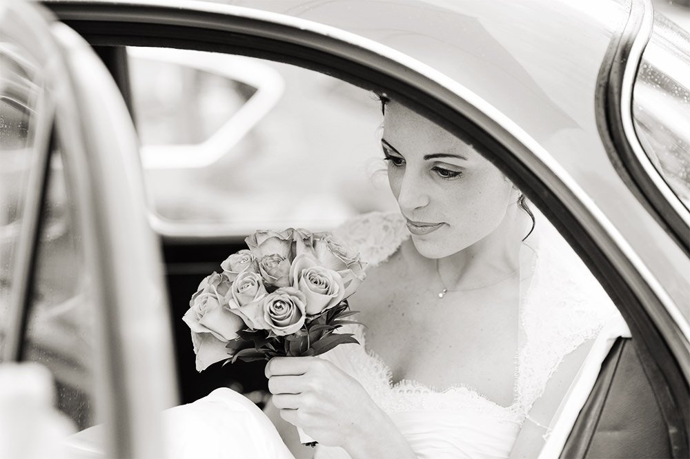 Black and white wedding photography of the bride arriving at her wedding at Losehill House.