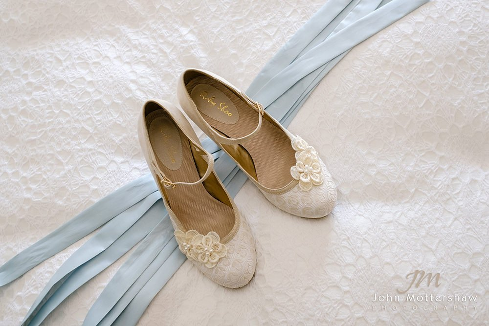 wedding photograph of a bride's shoes