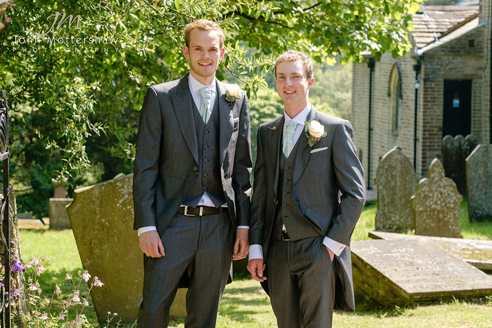 wedding photograph of a groom and his groomsmen at Taxal Church near Cheshire