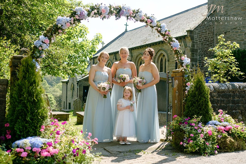 bridesmaids arrive at a wedding at Taxal Church near Cheshire