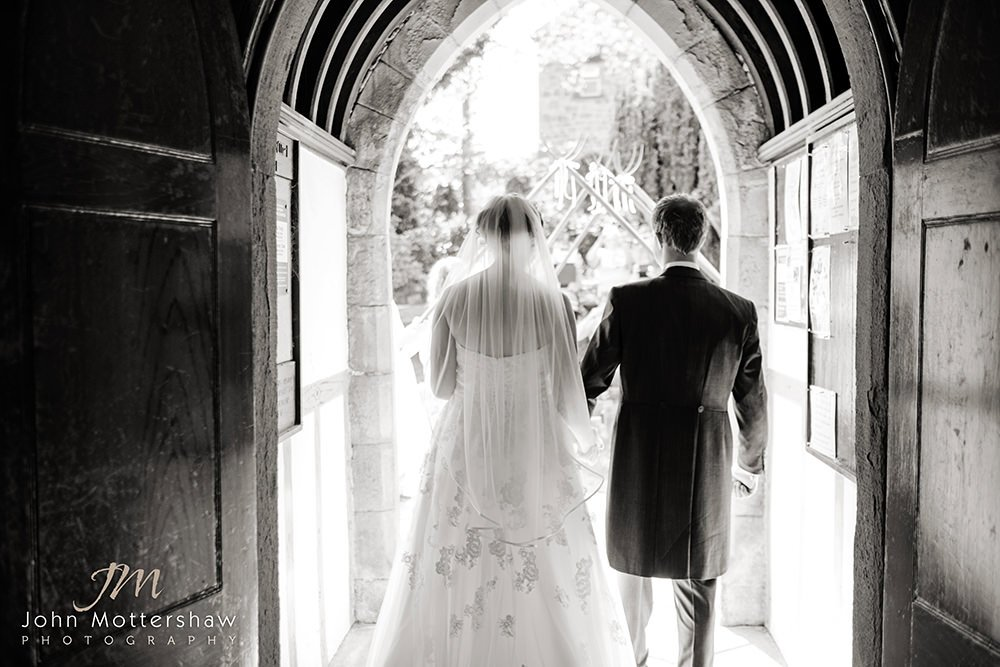 bride and groom leave their Cheshire church wedding. Black and white wedding photography.