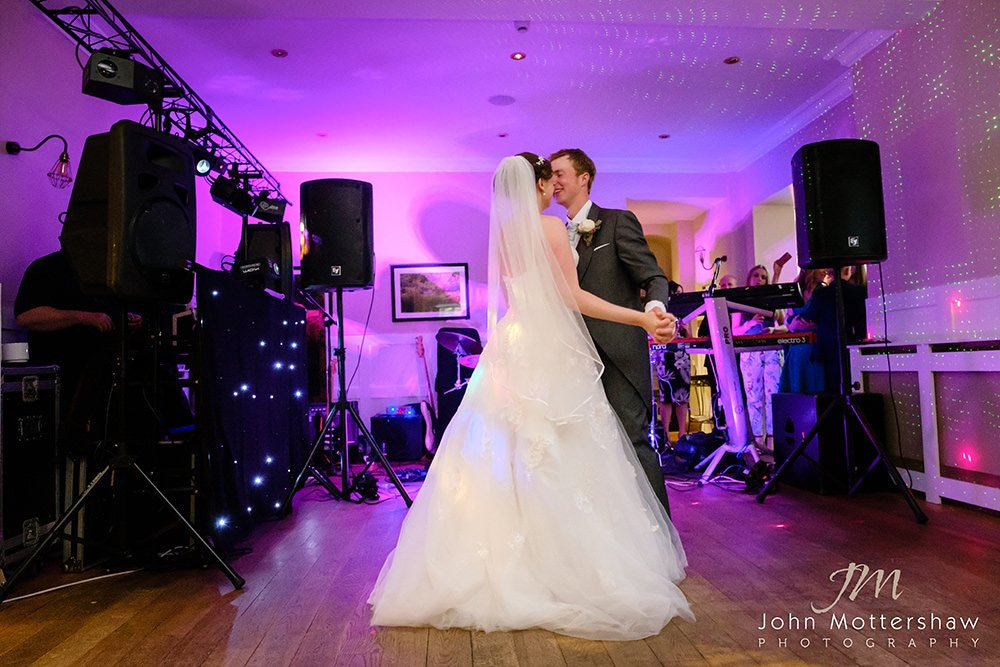 colourful wedding photograph of the first dance