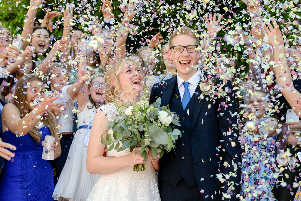 Training for wedding photographers showing lots of confetti at a wedding in Buxton, Derbyshire