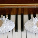 Bride's shoes on the keys of a piano. Unusual detail shot at a Buxton wedding by photographer John Mottershaw.