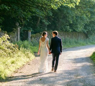 Wedding photographer at Hargate Hall near Buxton shows bride and groom in evening sunshine.