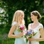 Bride and her bridesmaid sharing a moment at Hargate Hall.
