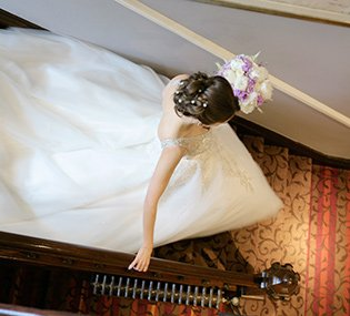 bride descends the staircase to her wedding at The Maynard in Grindleford, Peak District
