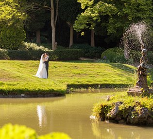A couple enjoy the beautiful evening light by the lake at their wedding at Thornbridge in Derbyshire.