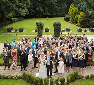 A large group shot from above at a wedding at Whitley Hall, one of the best known wedding venues in Sheffield.