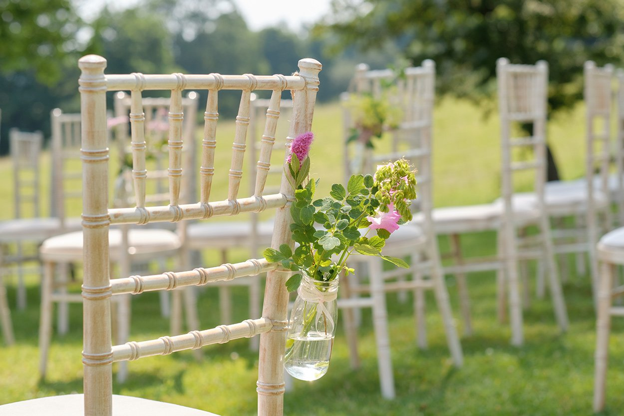 Wedding details: tiny bouquet in a jar in the Derbyshire countryside.