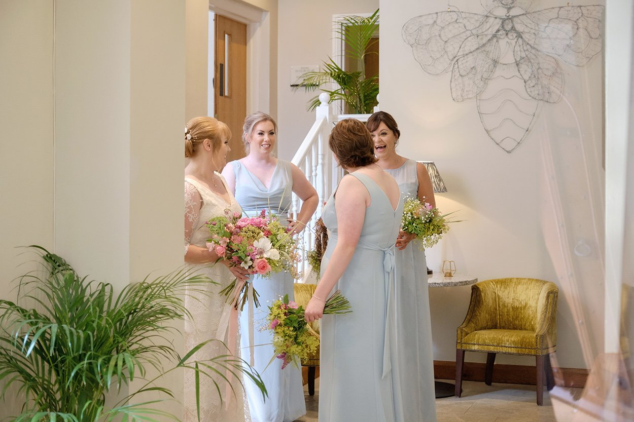 Bridesmaids and bride chat before a wedding at Losehill House.