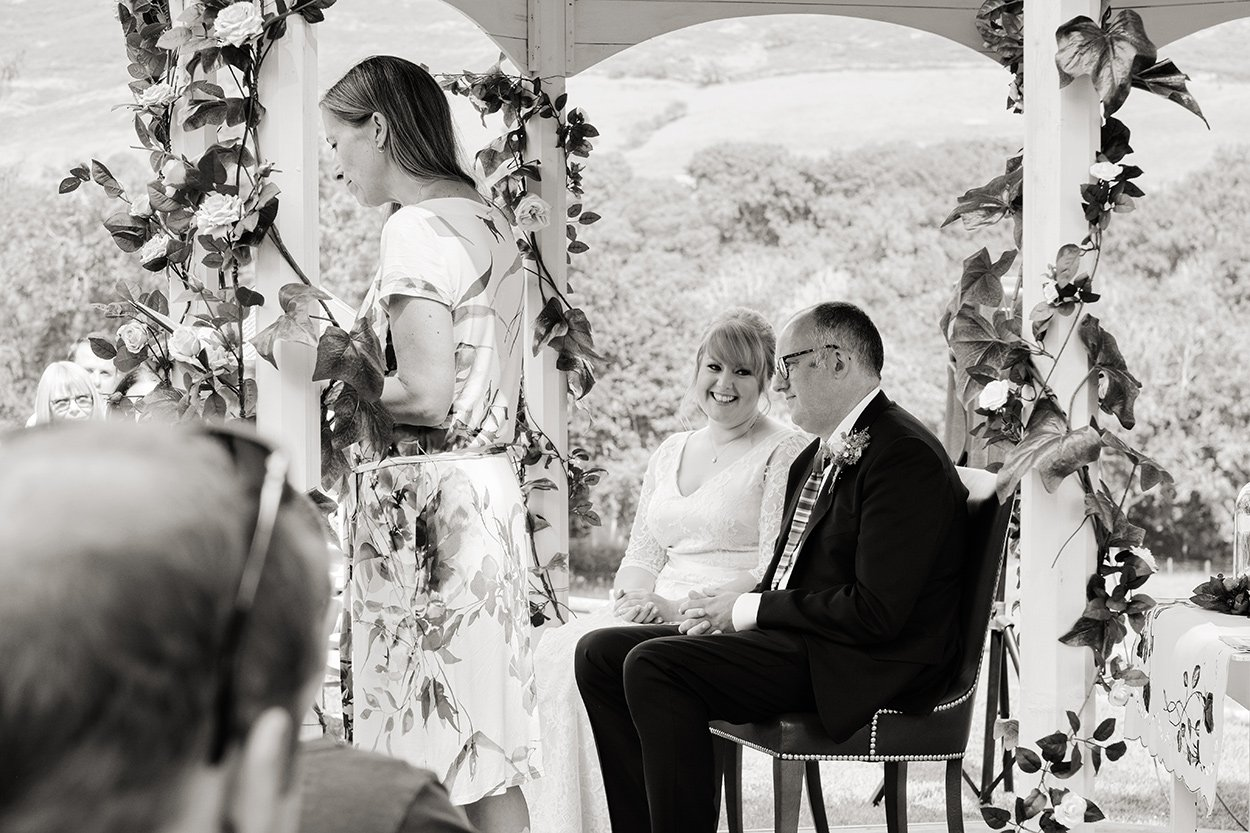 Bride looks at her groom during the ceremony at their wedding at Losehill House in Derbyshire