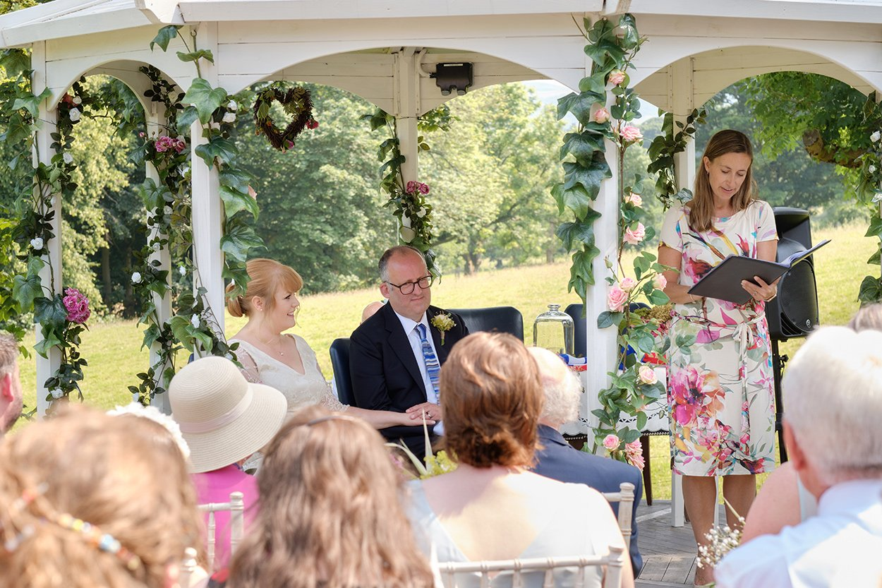 A humanist wedding ceremony outdoors on a warm summer day in the Derbyshire Peak District.