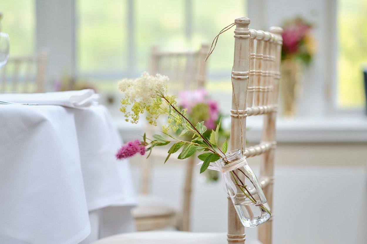 Detail shot indoorsat a summer wedding breakfast