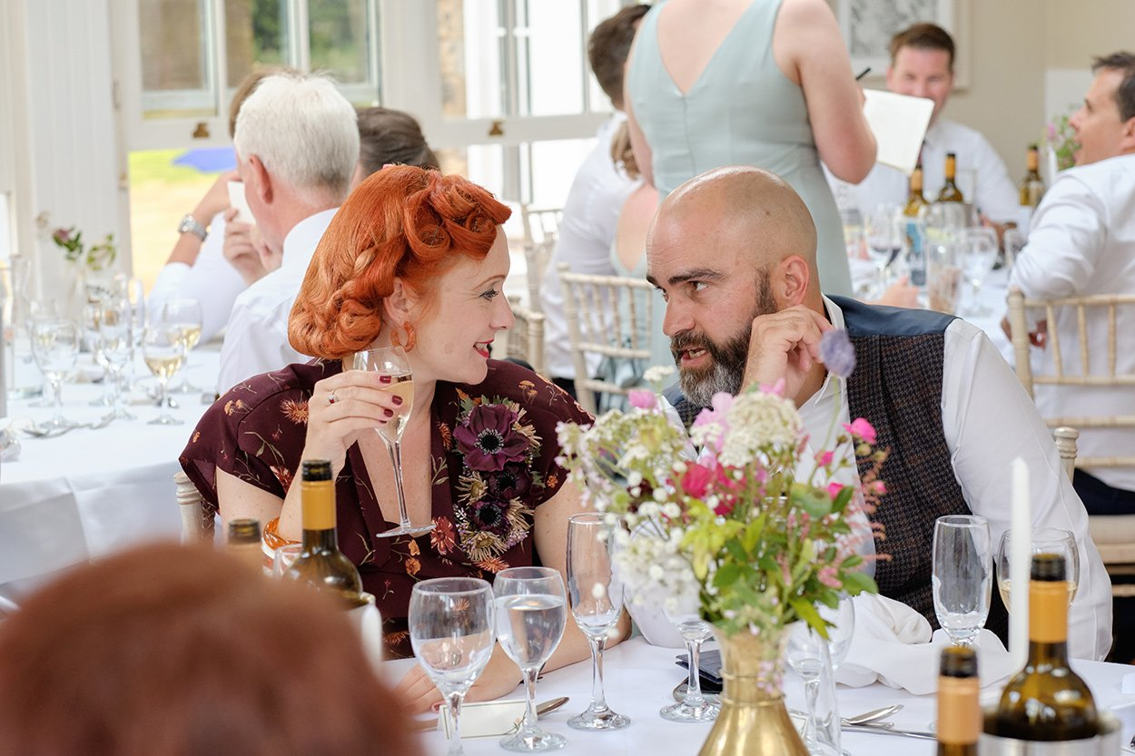 guests chat at a wedding in the Peak District