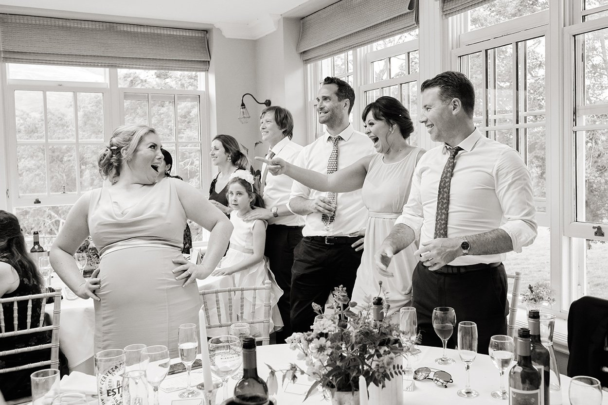 Laughter during the wedding celebrations, after the meal. Informal reportage