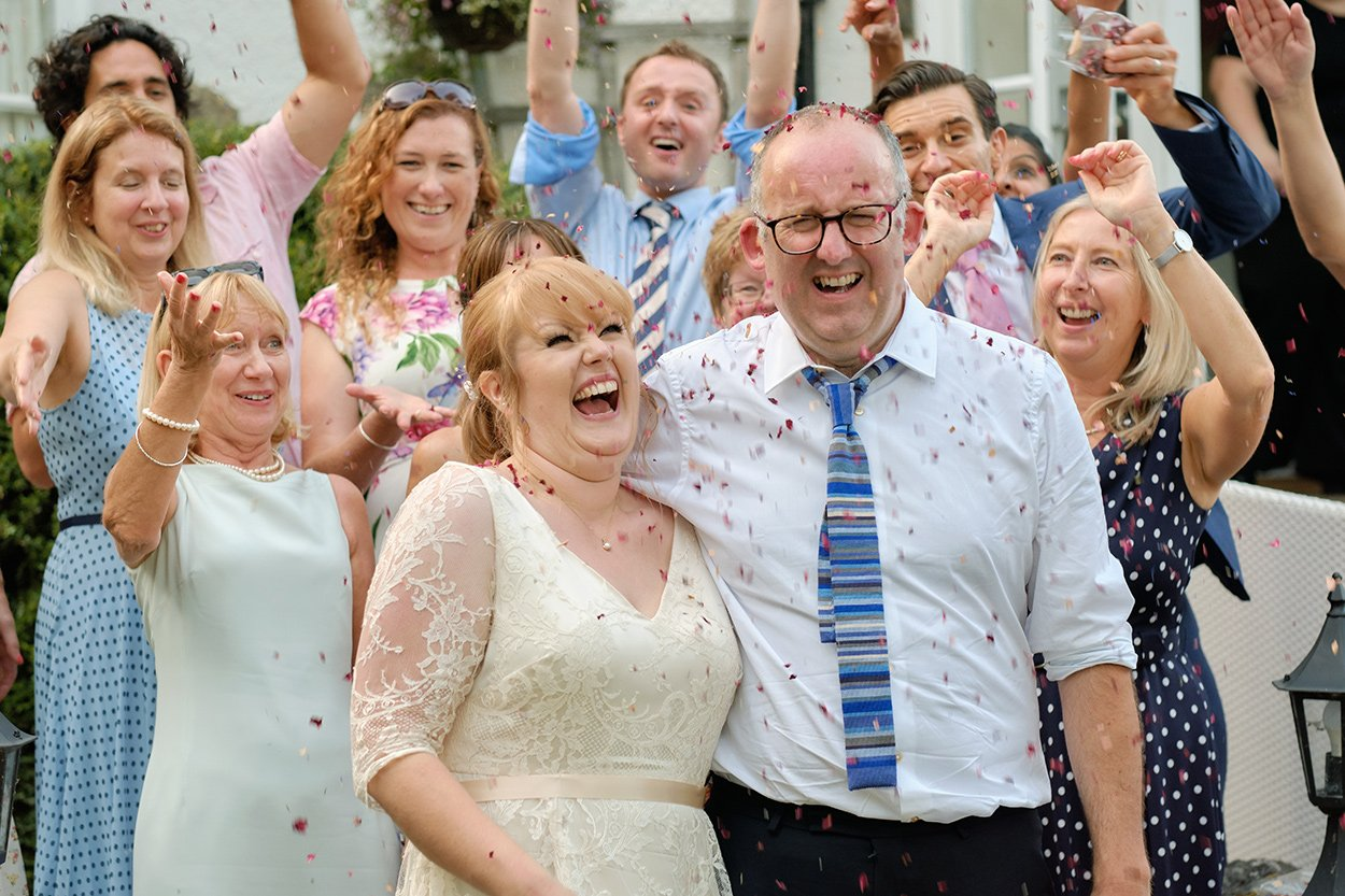 Confetti photograph at a joyous summer hotel wedding in Derbyshire with lots of laughter